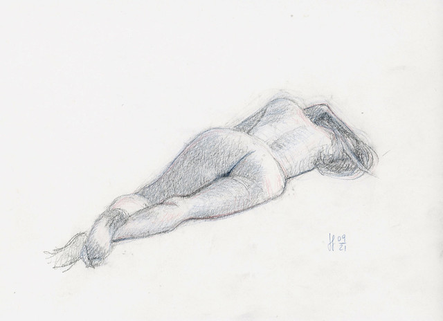 Nude laying in graphite and colored pencils