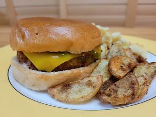 Plant Nation Burger with aioli, ketchup, shitty Coles cheese, and gerkhin relish