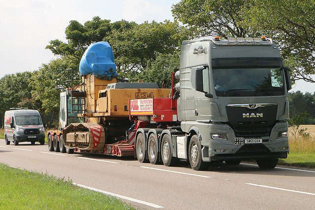 McIntosh Heavy Logistics MAN TGX 41 580 SW 21 GXA.