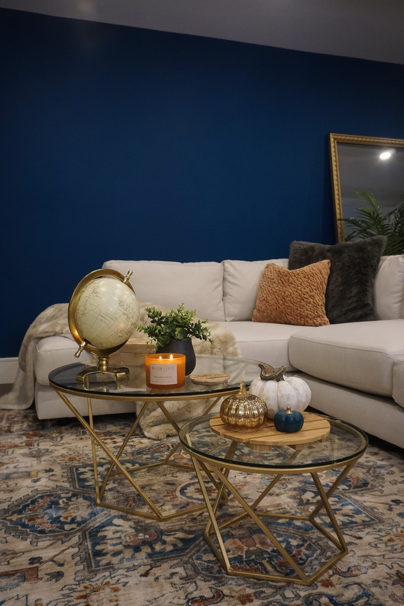 Living Room Fall Decor | Blue Walls | White Sectional Couch | Pumpkin Table Decor | Fall Candle on Coffee Table