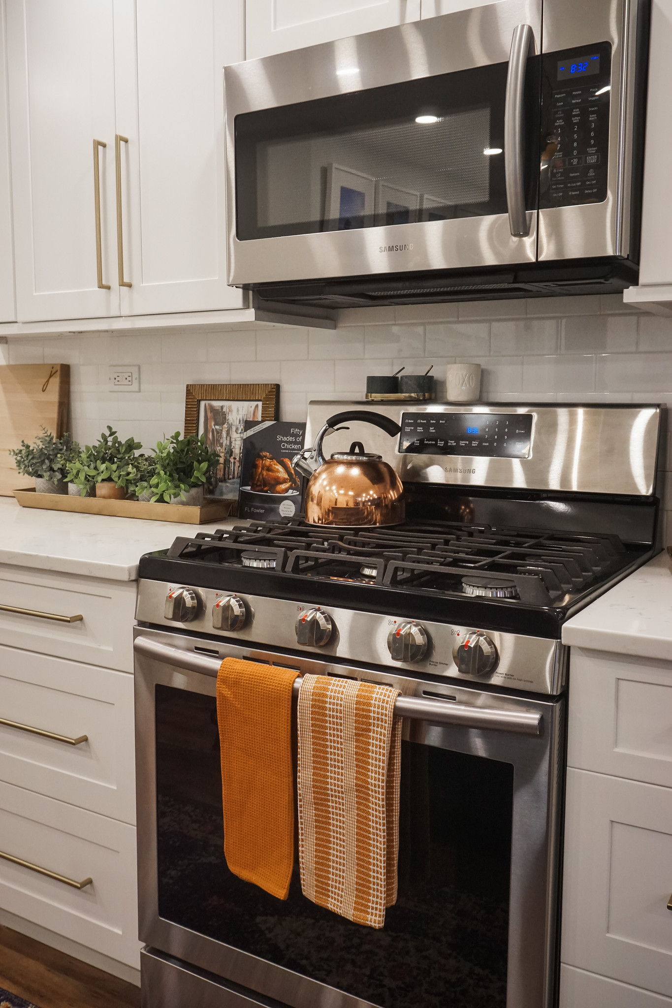 Burnt Orange Kitchen Hand Towels | Stainless Steel Stove | White Shaker Cabinets