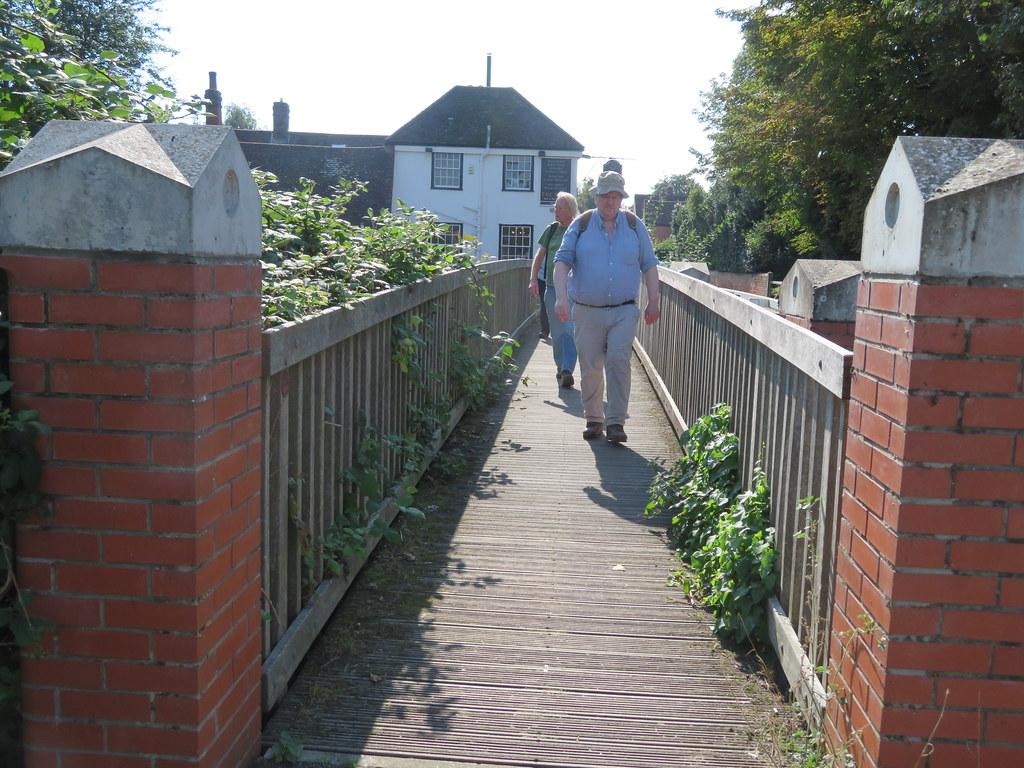 UK - Essex - Chappel - Walking across footbridge after leaving the Swan