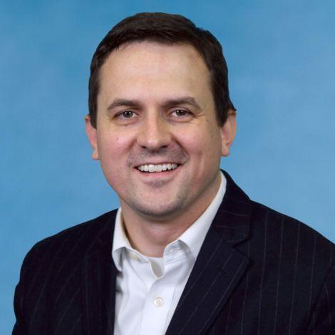 A photograph of Assistant Professor Bradley Hendricks
