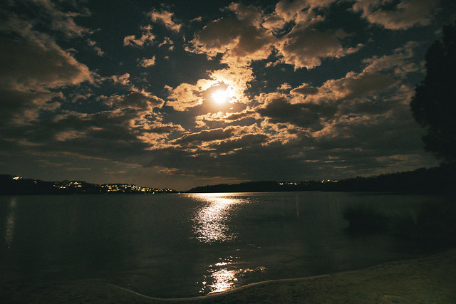Cloudy moonlight over the lake