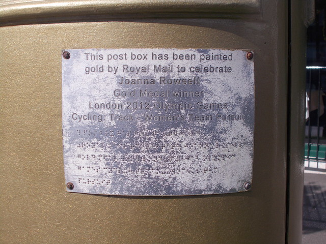 Inscription on the gold EIIR pillar box in Cheam Village