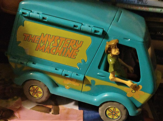 Scooby Do Cartoon by Hanna Barbera Mystery Machine with Shaggy and the whole gang in the van. Retro Toy Van
