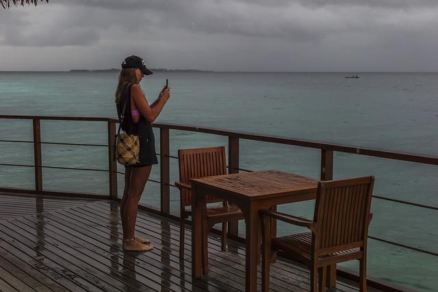 Maldives. Girl. Rain.