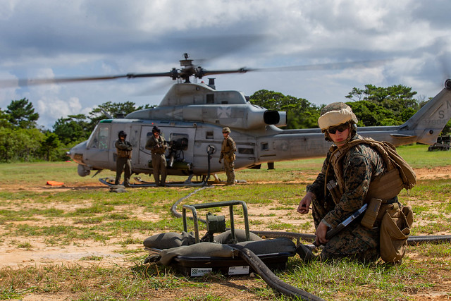 U.S. Marine Corps bulk fuel specialist checks active fuel lines during a forward refueling point operation