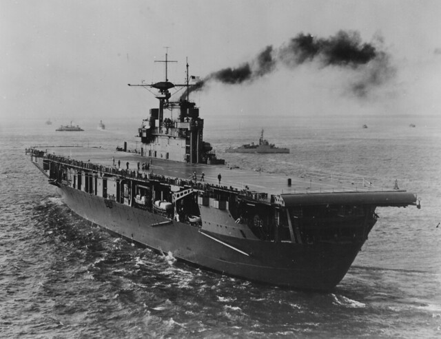 USS HORNET (CV-8)  soon after completion, probably at a U.S. east coast port. A ferry boat and Eagle Boat (PE) are in the background 1941.