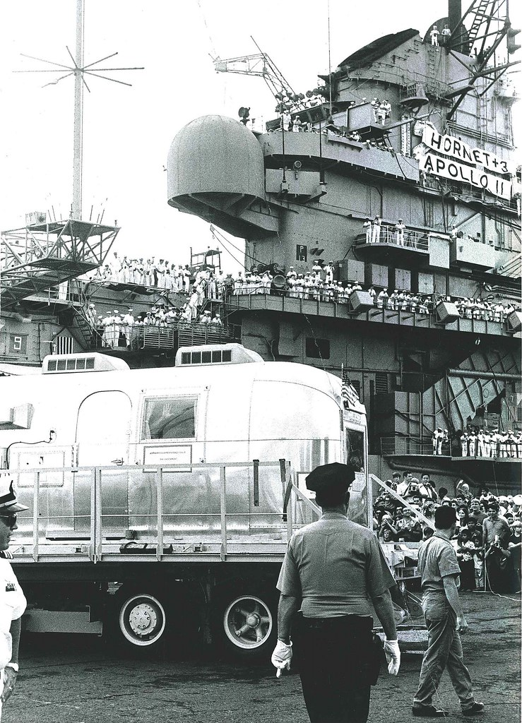 The Mobile Quarantine Facility containing the Apollo 11 astronauts is offloaded from USS Hornet (CVS-12) at Pearl Harbor on July 26, 1969.