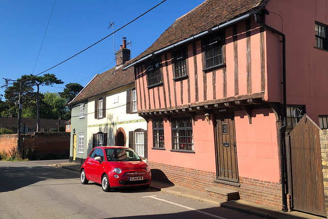 Fiat 500 outside timber framed historic building in Hadleigh, Suffolk.