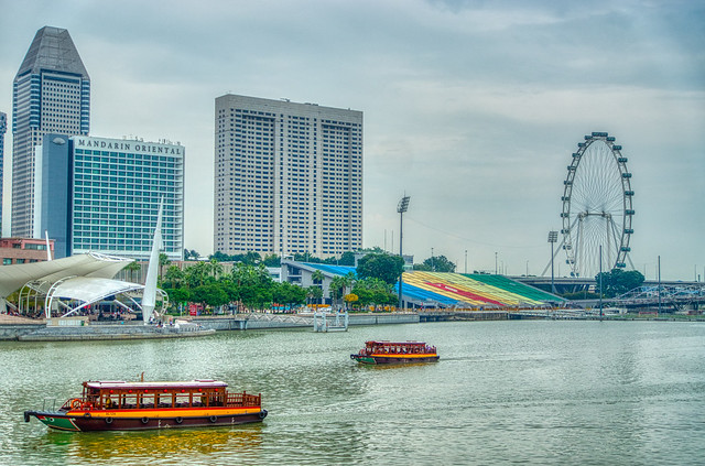 Marina Bay with Tourist Bum Boats, F1 Grandstand and ferris wheel in Singapore