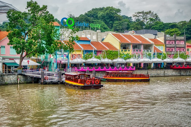 Tourist Bum Boats on the Singapore river at Clarke Quay