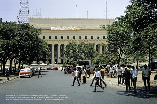Philippines, pedestrians crossing Taft Avenue near Manila Post Office, between 1959 and 1961