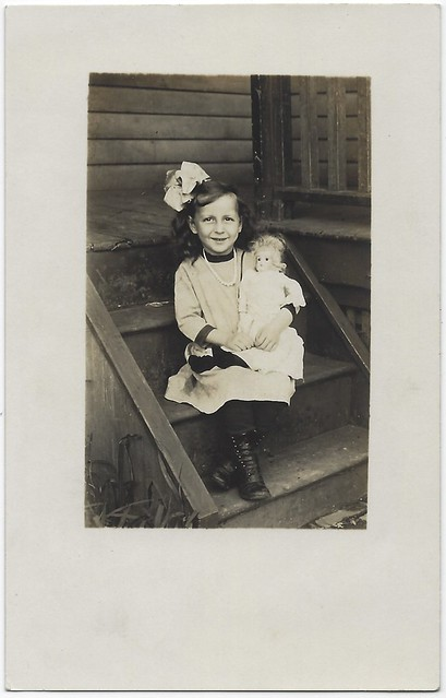 Unidentified Girl With Doll. RPPC.