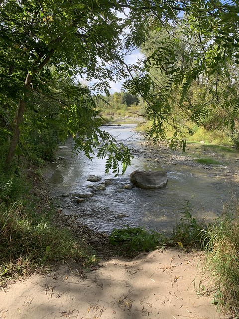 A large stone in the middle of Duffins creek in Green wood conservation area , Martins photograph , Ajax , Ontario , Canada , September 19. 2021