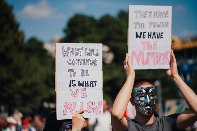 People wearing Guy Fawkes masks at an anti-vaccination protest in Vienna