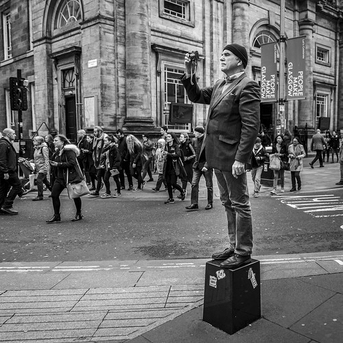 leanneboulton people streetphoto scotland urban street candid portrait streetphotography candidstreetphotography candidportrait streetlife square crop format man male expression face atmosphere photographer camera photography perspective standing platform elevation height bollard stool pointofview pov tone texture detail depthoffield naturallight outdoors city scene human life living humanity society culture lifestyle canon canon5dmkiii 24mm wideangle ef2470mmf28liiusm black white blackwhite bw mono blackandwhite monochrome glasgow uk buchananstreet