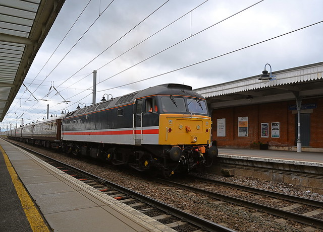 This train was the first of two ECS moves within 30 minutes. Swallow liveried 47828 top n tail with D1935 makes its way through Ely station, with the empty coaching move from the reception siding to Crewe. 08 08 2021