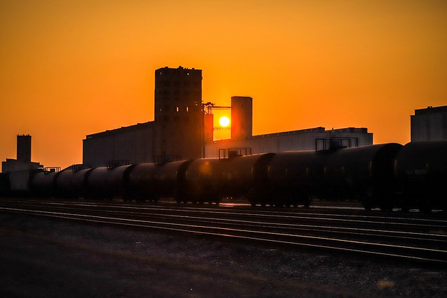 setting sun behind grain elevators / General Mills Terminal Elevator, Union Equity Co-Operative Exchange Elevator A