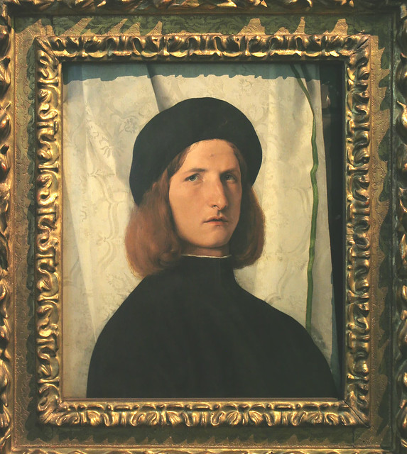 Young Man before a White Curtain