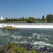 The river and waterfalls of Idaho Falls Idaho, with the famous mormon temple church in the background