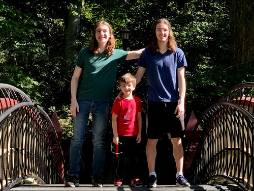 Patrick Glenn '23 takes a photo on the Crim Dell with his two younger brothers. Glenn's parents, Meredith '96 and John Glenn '95, are both alumni.