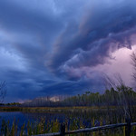 22. September 2021 - 19:47 - The follow up to the previous sunset photo titled 'Sanctuary Reflections' as the storm moved west and filled the horizon with lightning.  Clifford E Lee Nature Sanctuary Parkland County, Alberta Canada