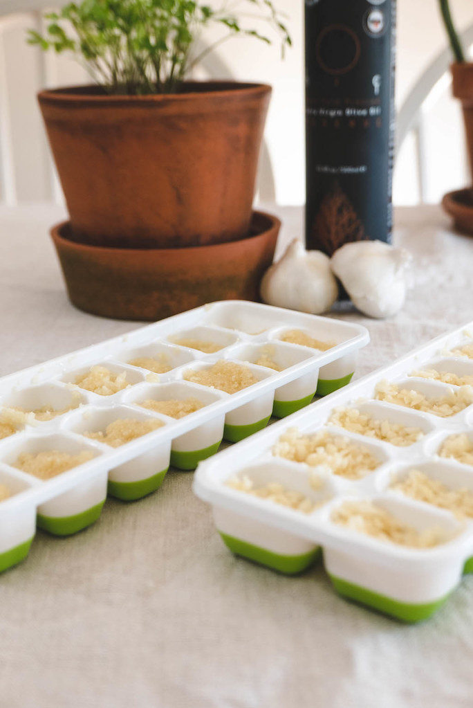 A side shot of minced garlic and garlic paste in ice trays.