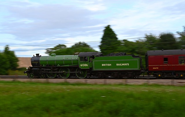 A 'pan' shot of Loco 61306 'Mayflower' hauling 1Z57, 18.23 Colchester - Norwich Steam Dreams Diner, part of the EUR 175 celebrations, just past Lancasters Crossing, Stowmarket. 14 08 2021