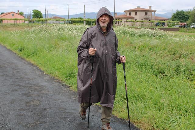 wearing a poncho on Camino de Santiago