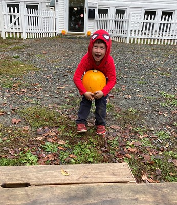 trying not to drop the pumpkin