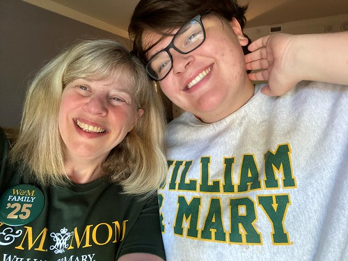 Adriano Moran '25 and Betsy Quint-Moran take a photo together during Family Weekend.