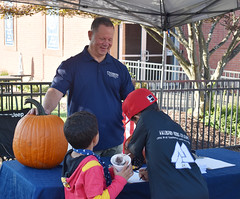 State Rep. Craig Fishbein looks on as kids try and guess the weight of a pumpkin to win a tour of the state capitol during the annual Celebrate Wallingford festival on October 2nd.