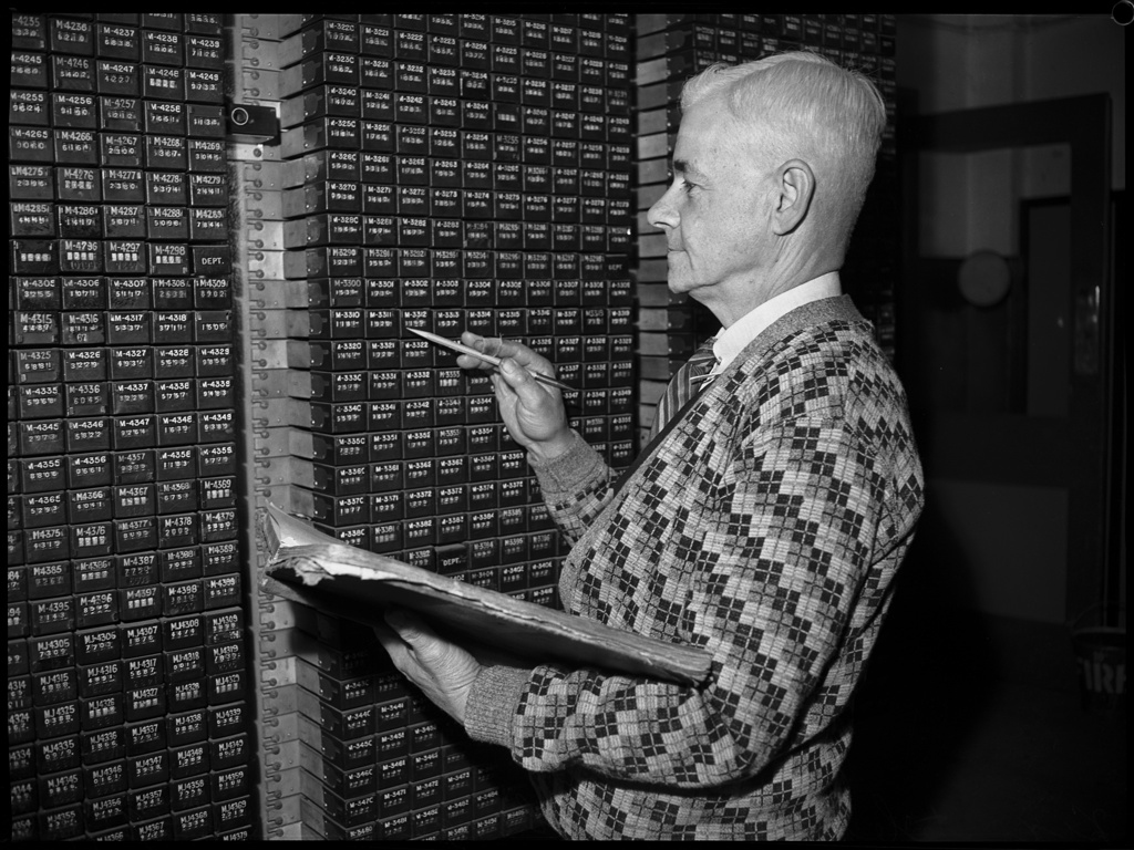 Portrait of a man in checked cardigan, Sydney telephone exchange, August 1946