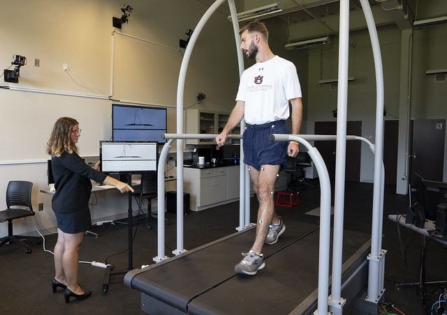 Jaimie Roper, assistant professor and director of the Locomotor and Movement Control Lab in the School of Kinesiology, directs Cole Burton, graduate teaching assistant and former participant in her lab.
