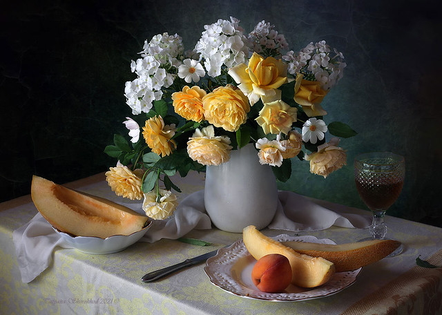 Still life with yellow roses and melon