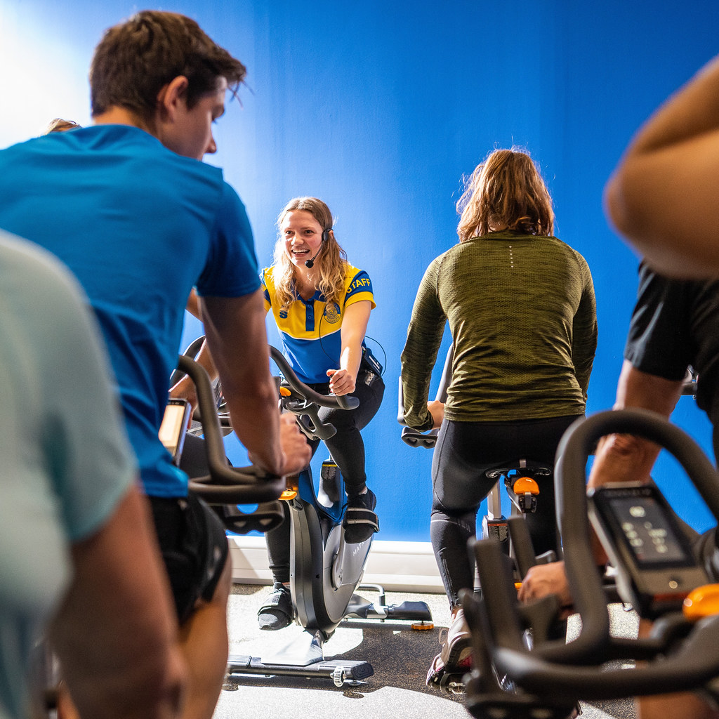 Students doing a Spin class at the Sports Training Village