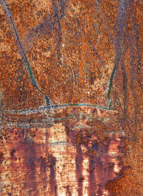 abstract texture of scraped rust on a dumpster