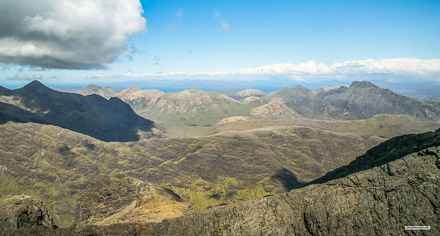 A view from Sgurr Alasdair. Left is Sgurr nan Gillean. Central are the red granite, Red Cuillins and right is an outlier of the Black Cuillins made of the same Gabbro and Basalt, Bla Bheinn, Skye, Scotland.