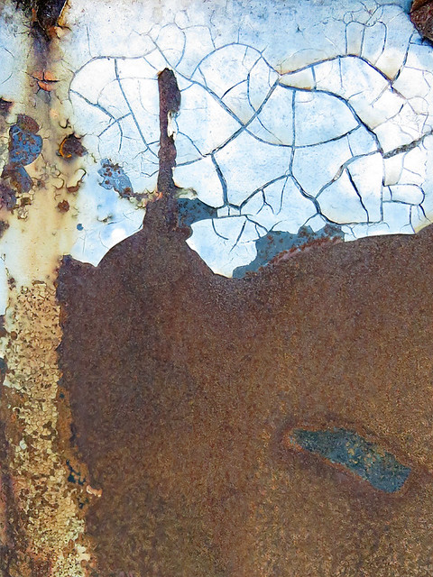 abstract texture of cracked rust on a dumpster
