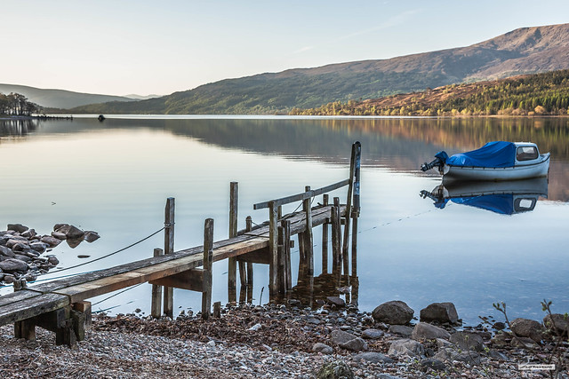 The silence was deafening. Beach, jetty, boat, Quicksilver water, hills, forest and me. Loch Arkaig at sunrise, nearing perfection. Lochaber, Inverness-shire, Scotland.