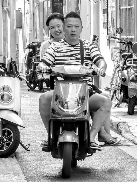 A couple on a scooter through one of Shanghai's oldest alleys, which is all set to be demolished.