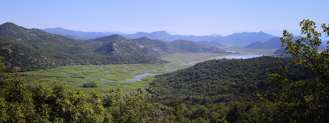The Crnojevic River meanders along the green hills surrounded by lush green plains