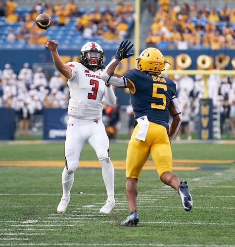Henry Colombi passing with Lance Dixon in his face (WVU vs TT)