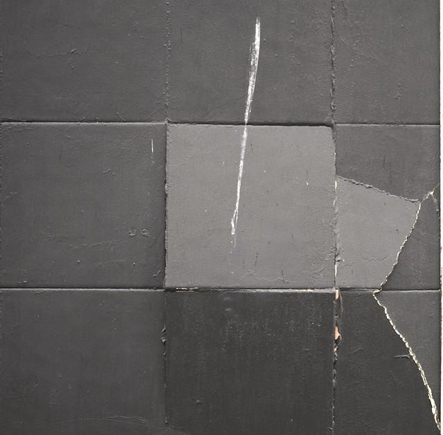 Three broken tiles & a streak of bird shit