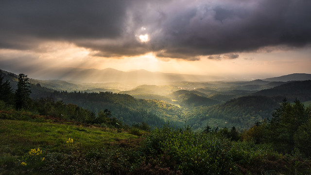 The sun shines through the cloud cover into the Murgtal in the northern Black Forest