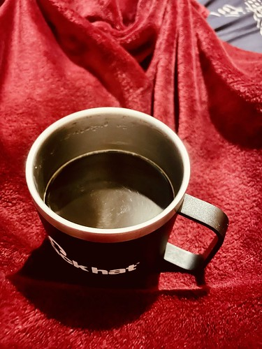 Warm cup of coffee in bed