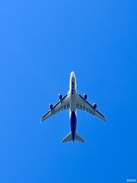 Forceful Fours Full Wingspan Jetliner Spans Blue Oceans To Span Blue Sky Above Me - IMRAN™