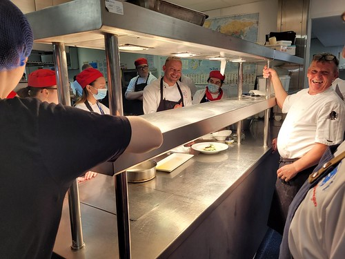 College students assist region's top chefs with charity fundraiser